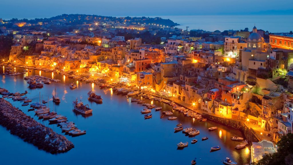 Marina Corricella on Procida Island at dusk, Bay of Naples, Campania, Italy