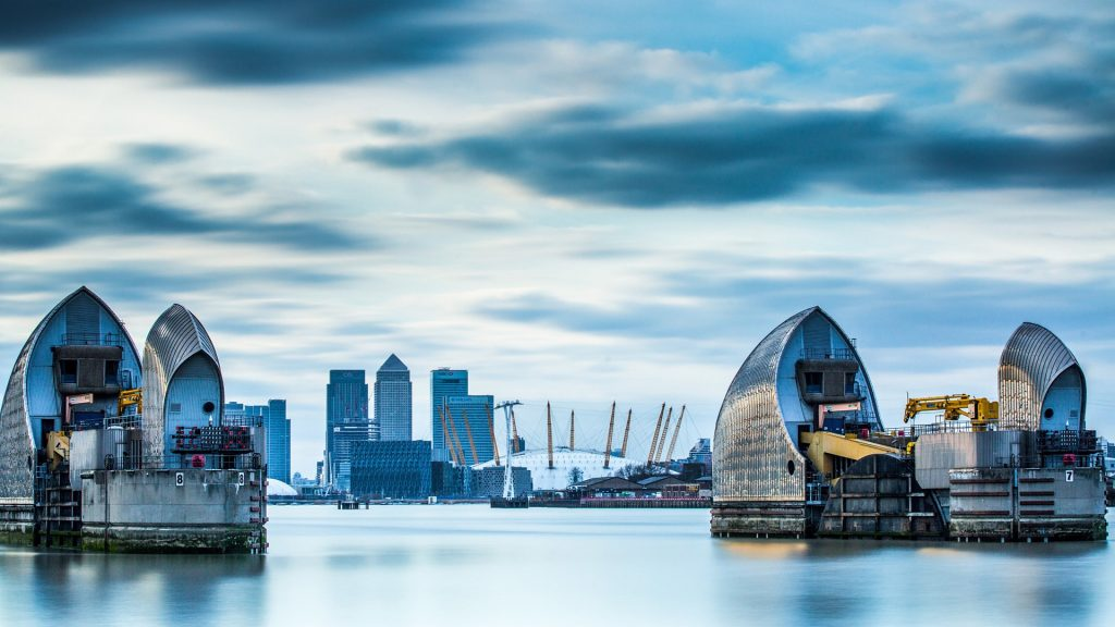 Thames Barrier on River Thames and Canary Wharf in the background, London, England, UK