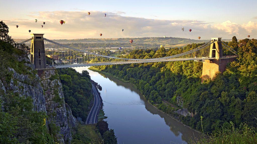 Clifton Suspension Bridge with hot air balloons in Bristol Balloon Fiesta, England, UK