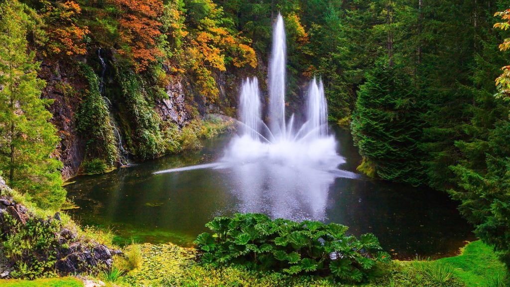 Dancing fountain in a quiet pond, Butchart Gardens on Vancouver Island, Canada