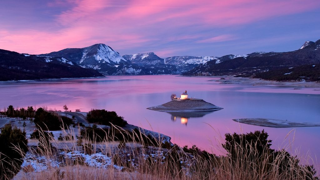 Saint Michel chapel on Lake Serre-Ponçon at dawn, Hautes Alpes, France