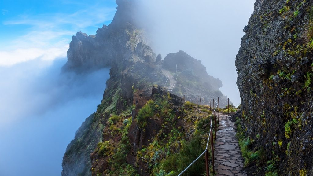 Mountain trail in Madeira above the clouds on a sunny afternoon, Portugal