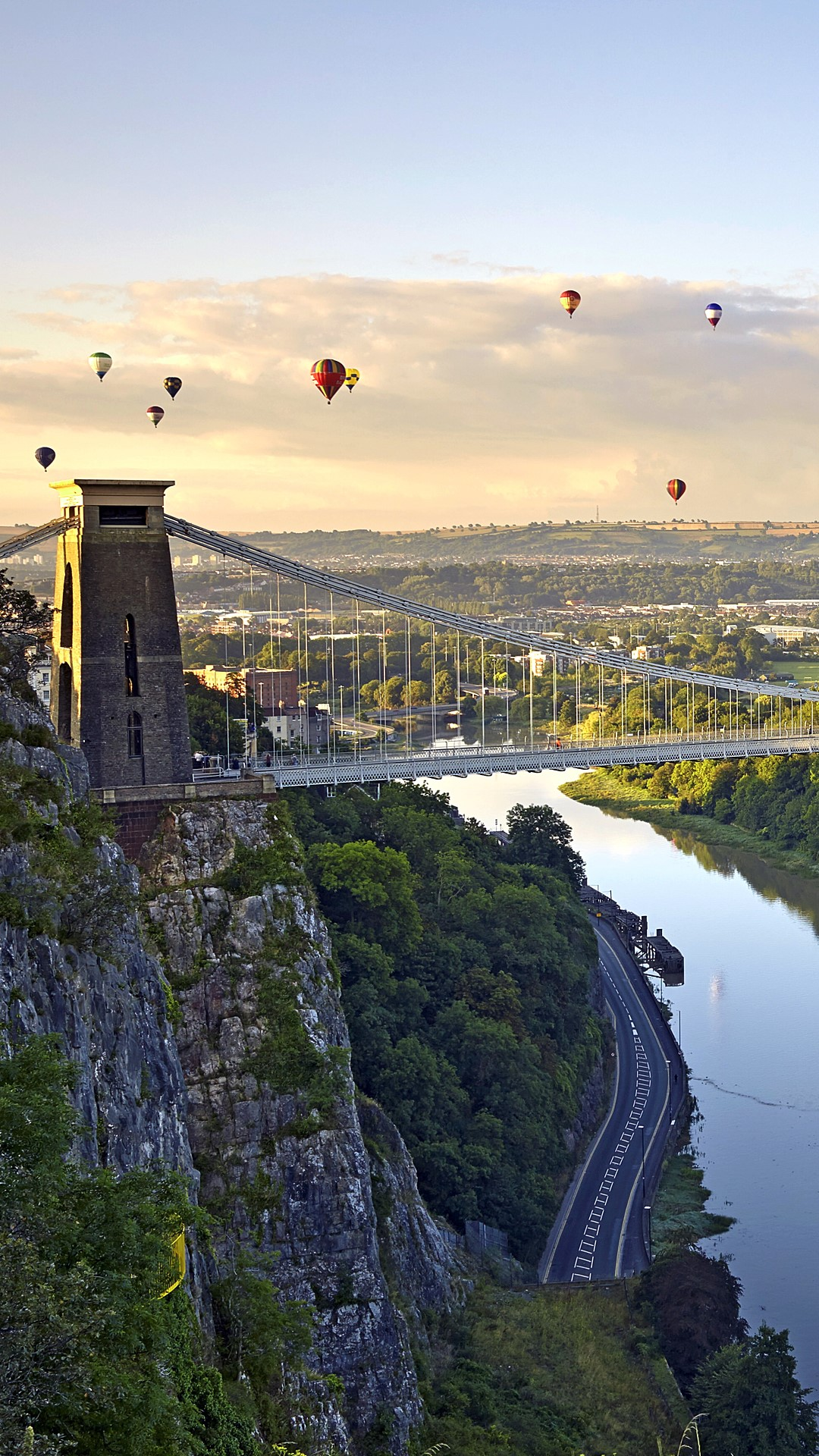 clifton suspension bridge with hot air balloons in bristol