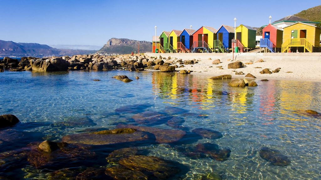 St James Beach and tidal pool with colourful huts, Cape Town, South Africa