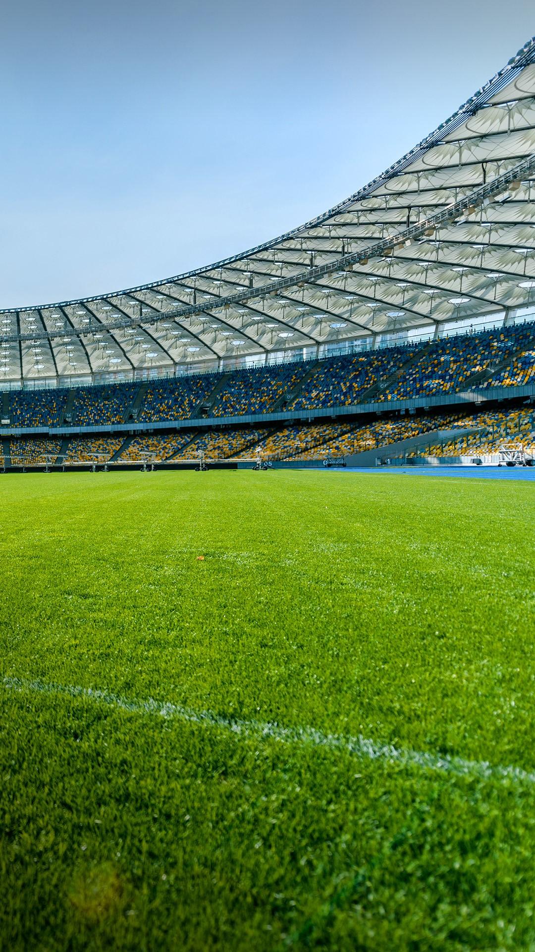 Panoramic view of soccer field stadium and stadium seats ...