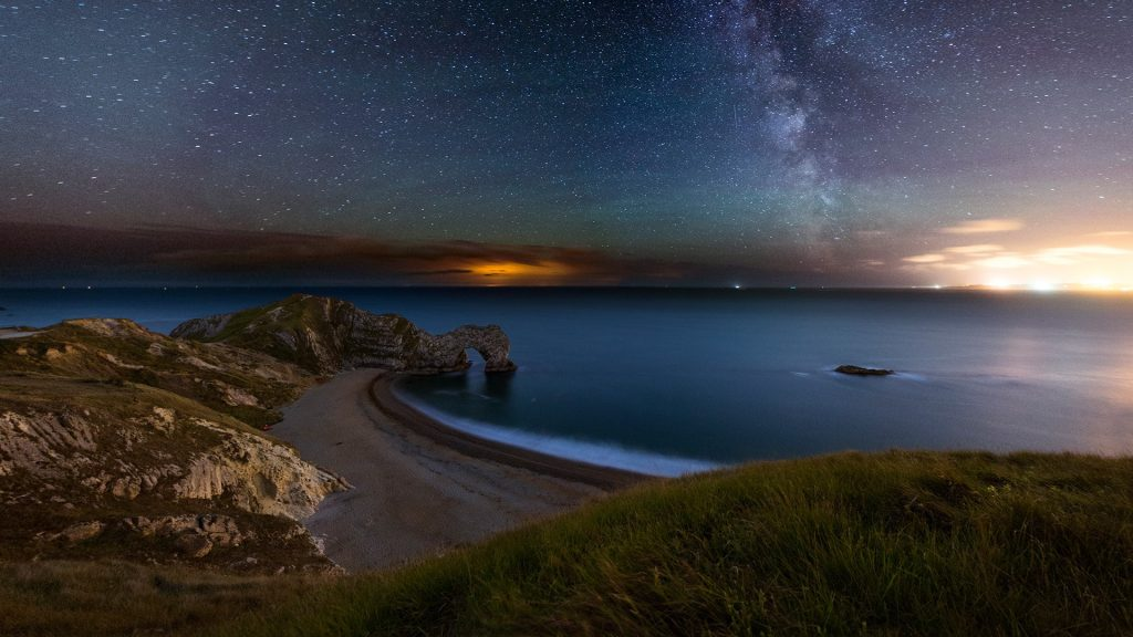 Night view of Durdle Door at Jurassic Coast in Dorset, England, UK