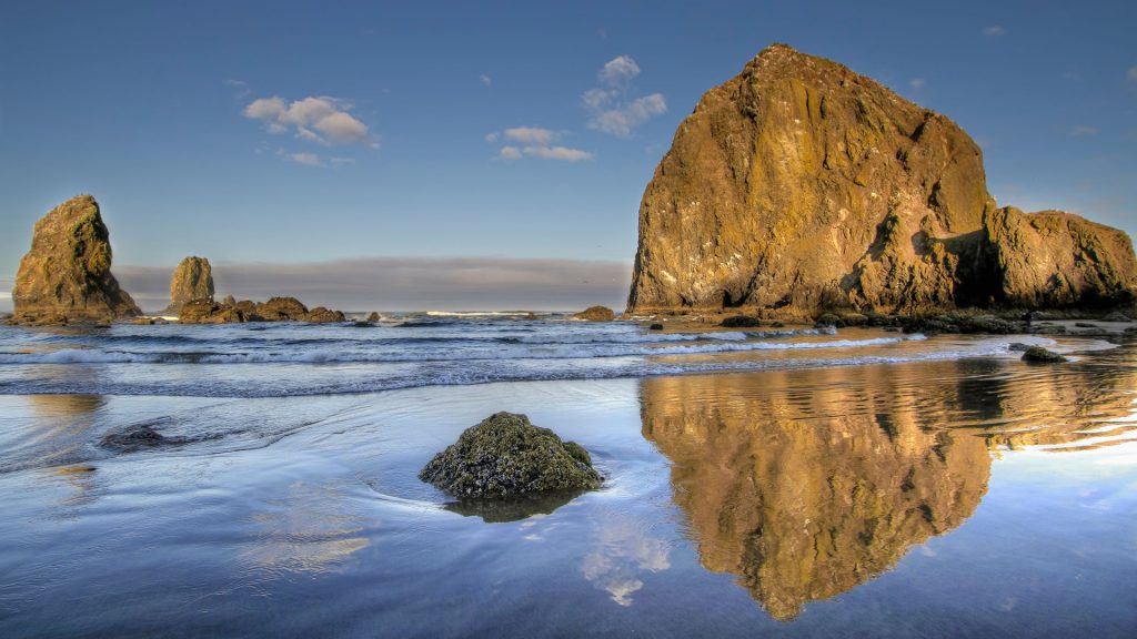 Reflection of Haystack Rock at Cannon Beach, Oregon, USA