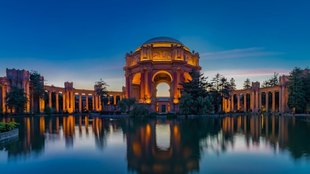 Illuminated Palace of Fine Arts at sunset in San Francisco, California, USA