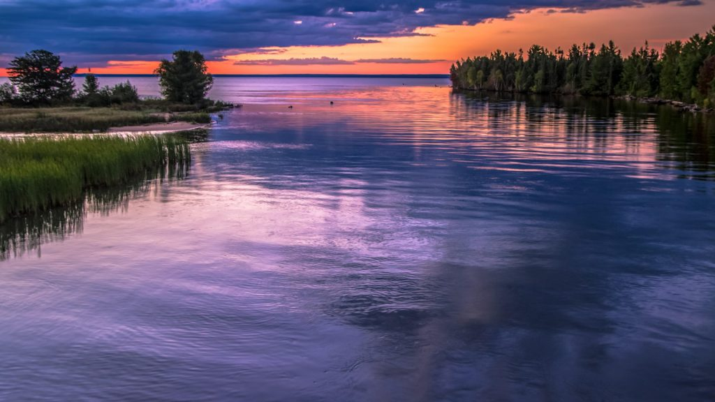 Sunset over Tahquamenon River as it enters Lake Superior, Michigan, USA