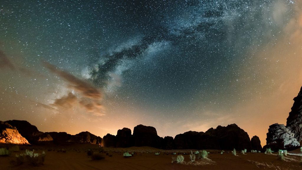 Milky way above red Wadi Rum desert at night, Jordan