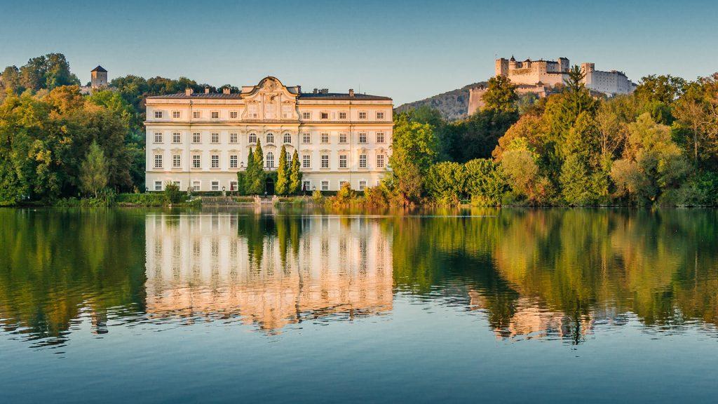 Schloss Leopoldskron with Hohensalzburg Fortress in Leopoldskron-Moos, Salzburg, Austria