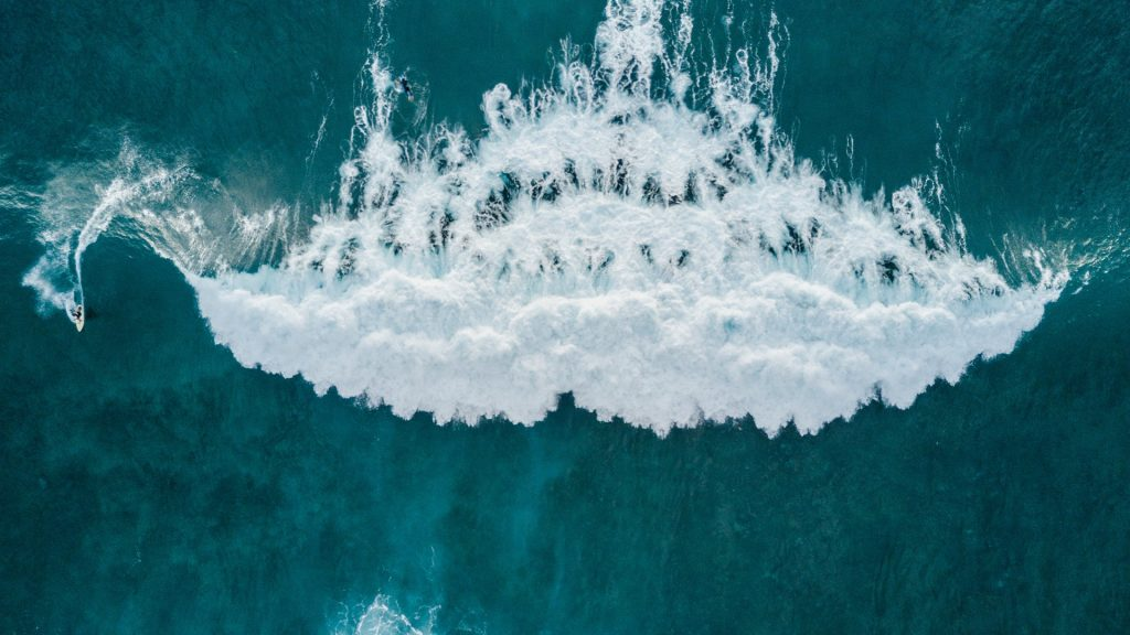 Aerial view of surfer catching big wave, Tenerife, Canary Islands, Spain