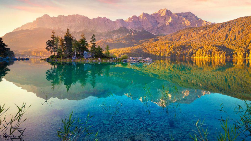 Summer sunrise on the Eibsee lake in German Alps, Germany