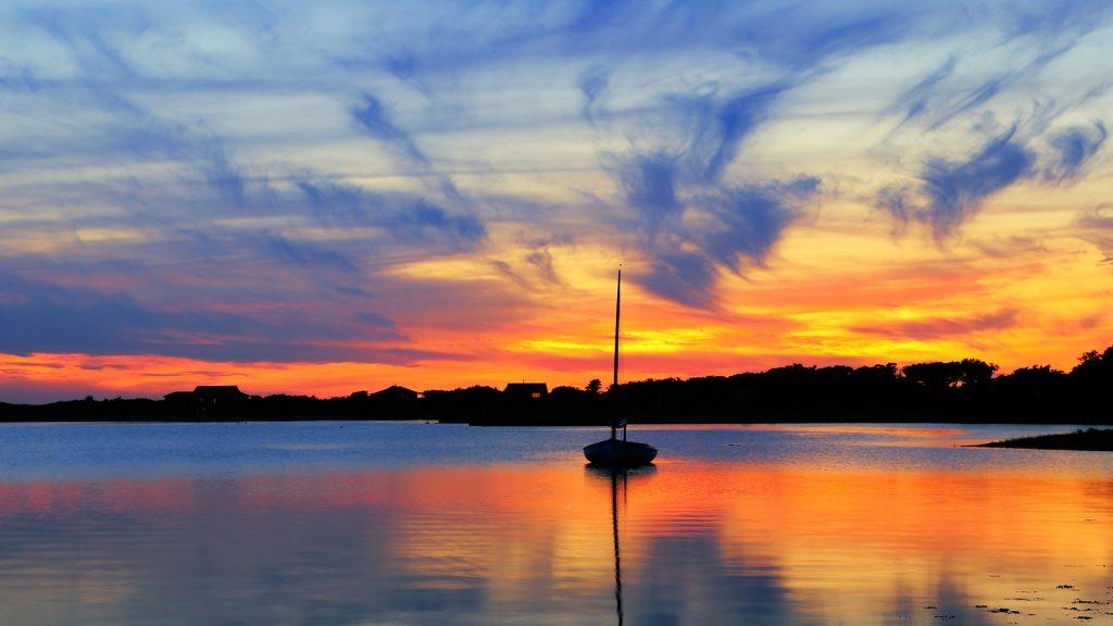 Sunset and sailboat in Martha's Vineyard, Massachusetts, USA