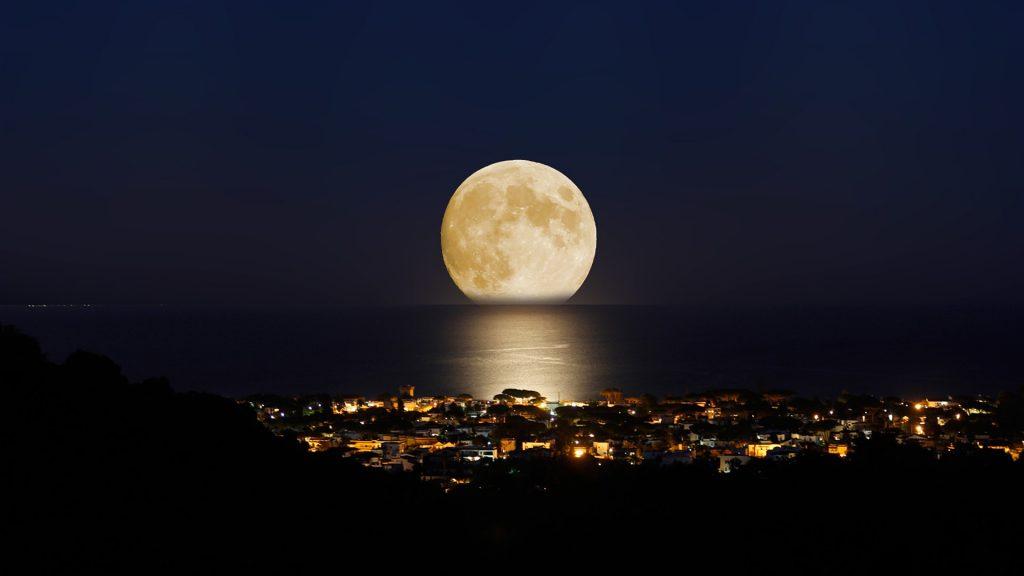 Summer moon and San Felice Circeo at night, Latina, Italy