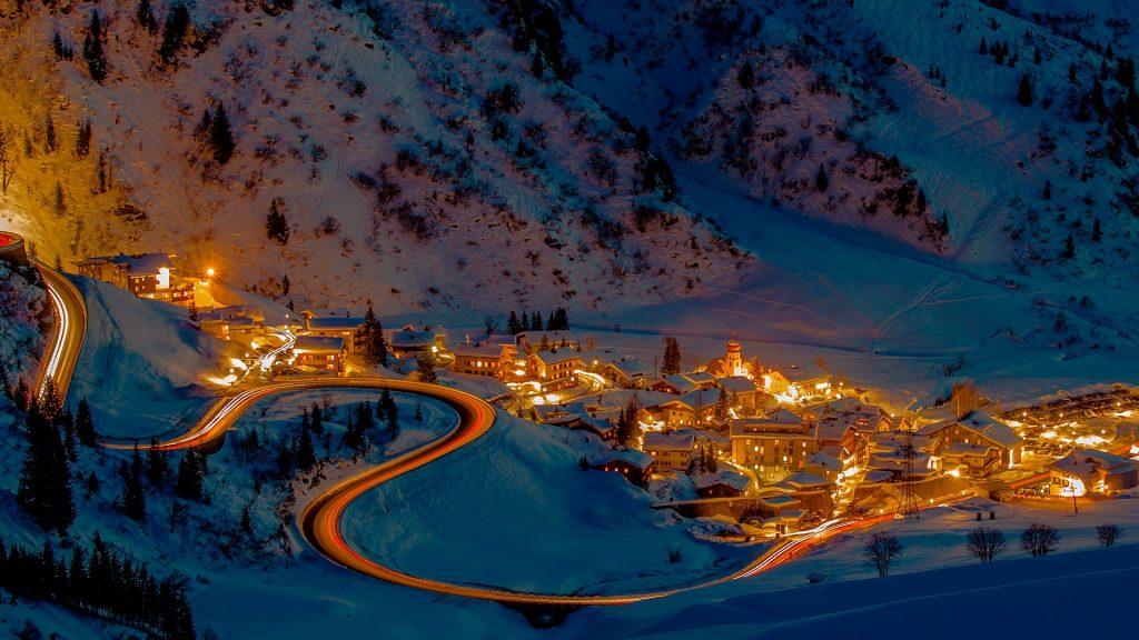 Little village Stuben am Arlberg with mountain pass at night, Klösterle, Austria