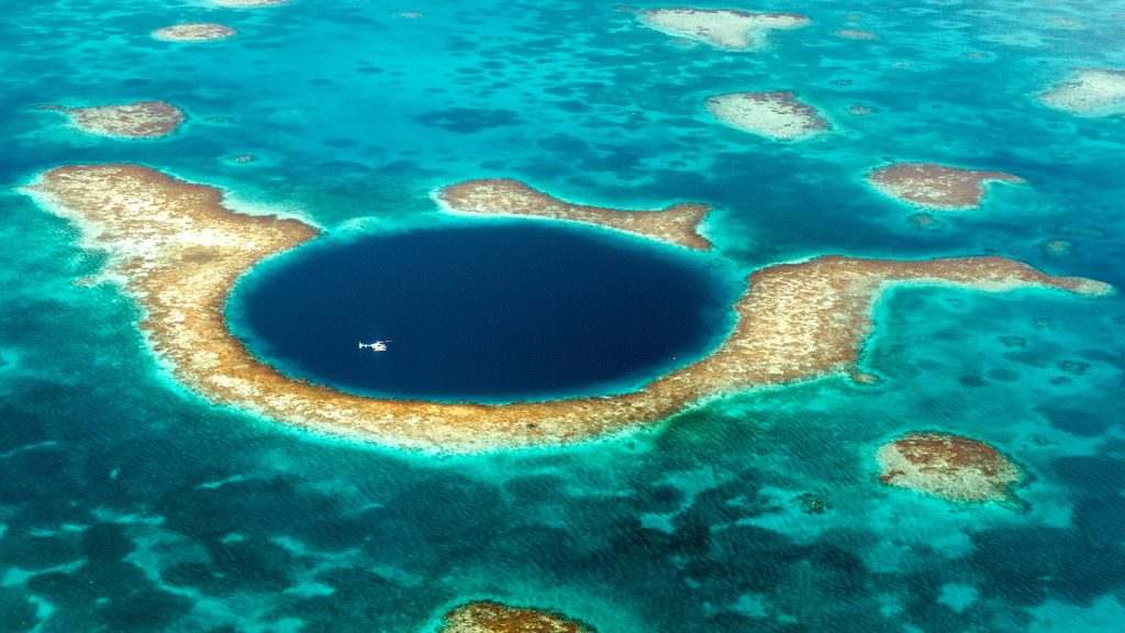 Helicopter above the Great Blue Hole, Belize Barrier Reef