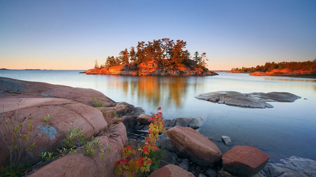 Autumn sunrise in Georgian Bay, Chikanishing River, Killarney Provincial Park, Ontario, Canada
