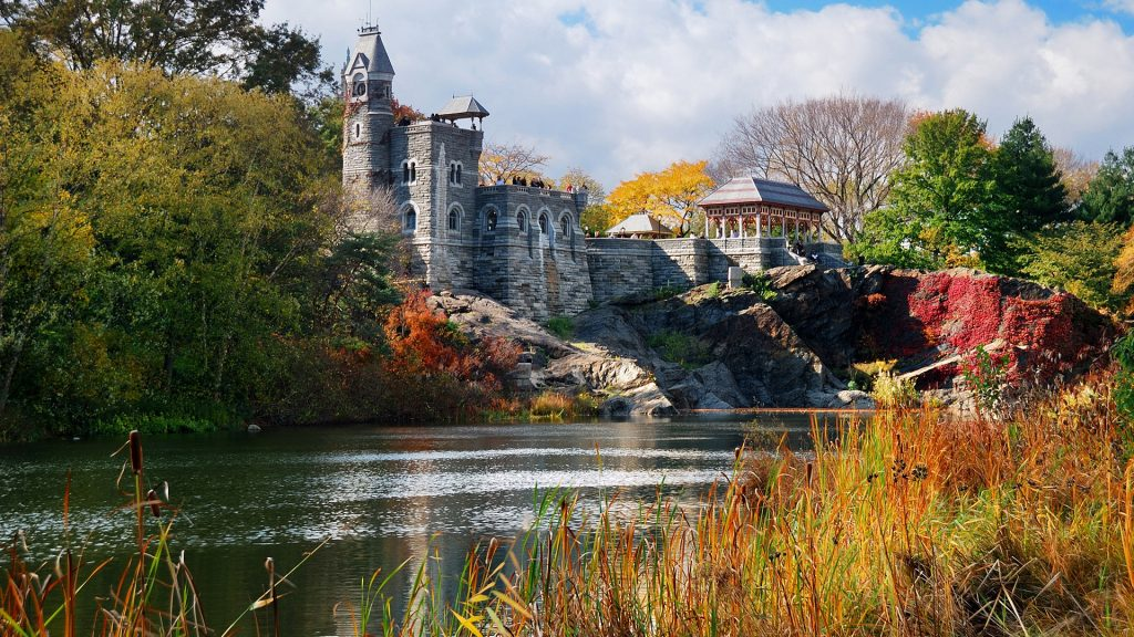 New York City Manhattan Central Park in autumn with Belvedere Castle and trees over lake, USA