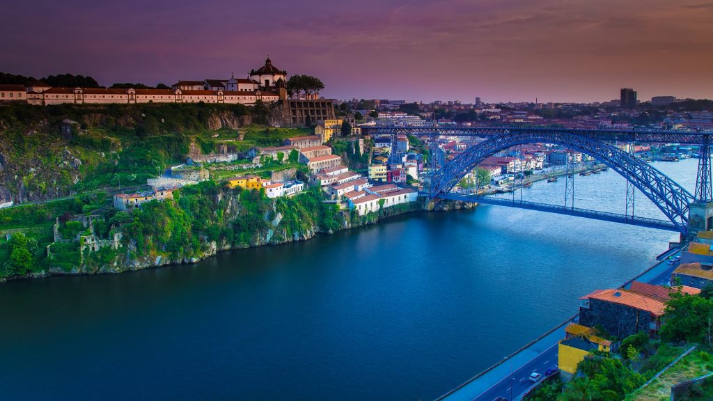 Old Town skyline across the Douro River and The Luis Bridge, Porto sunset, Portugal