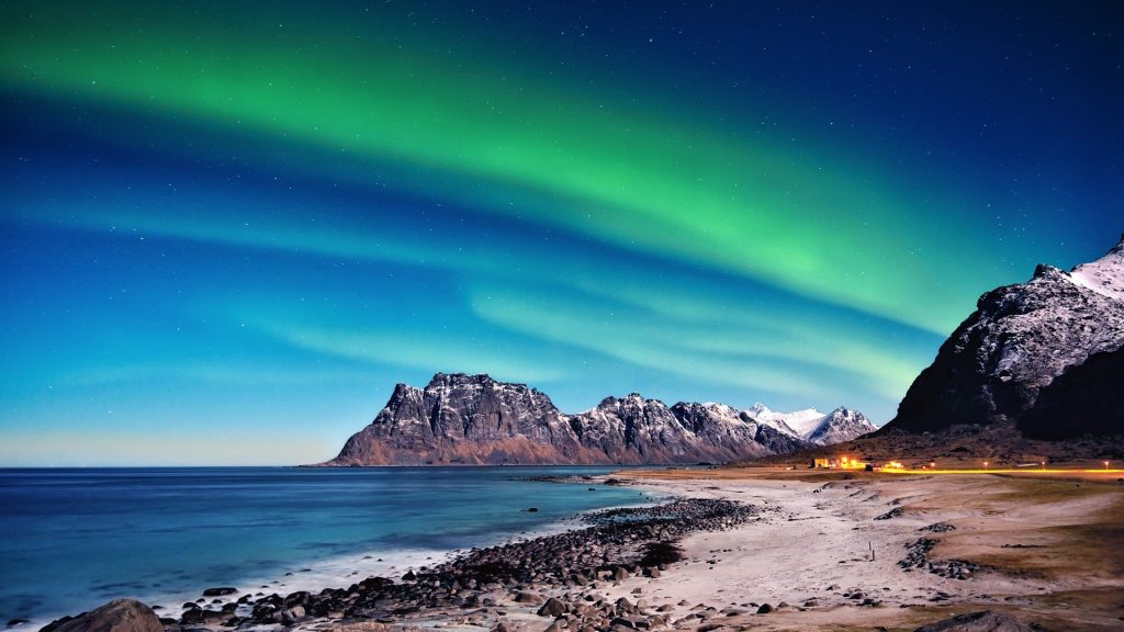 Northern lights over beach, Utakleiv, Nordland, Lofoten, Norway