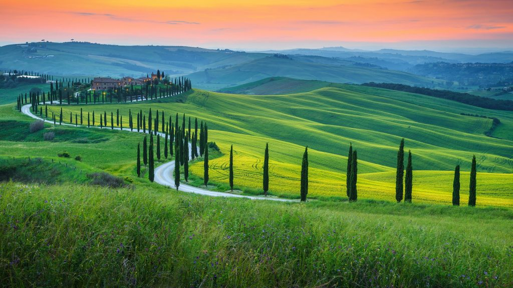 Famous Tuscany landscape with curved road and cypress, Crete Senesi at sunset, Italy