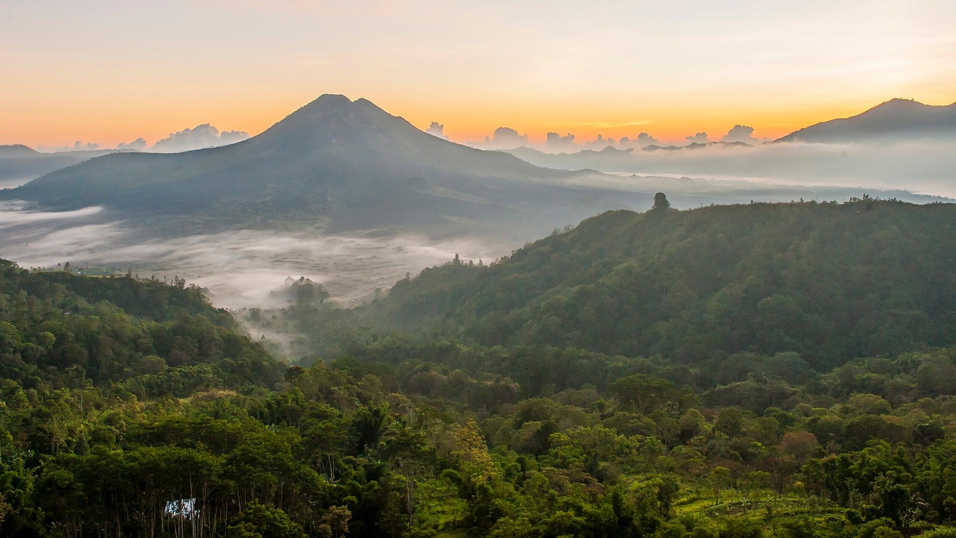 Hilltops over morning fog in remote landscape, Kintamani