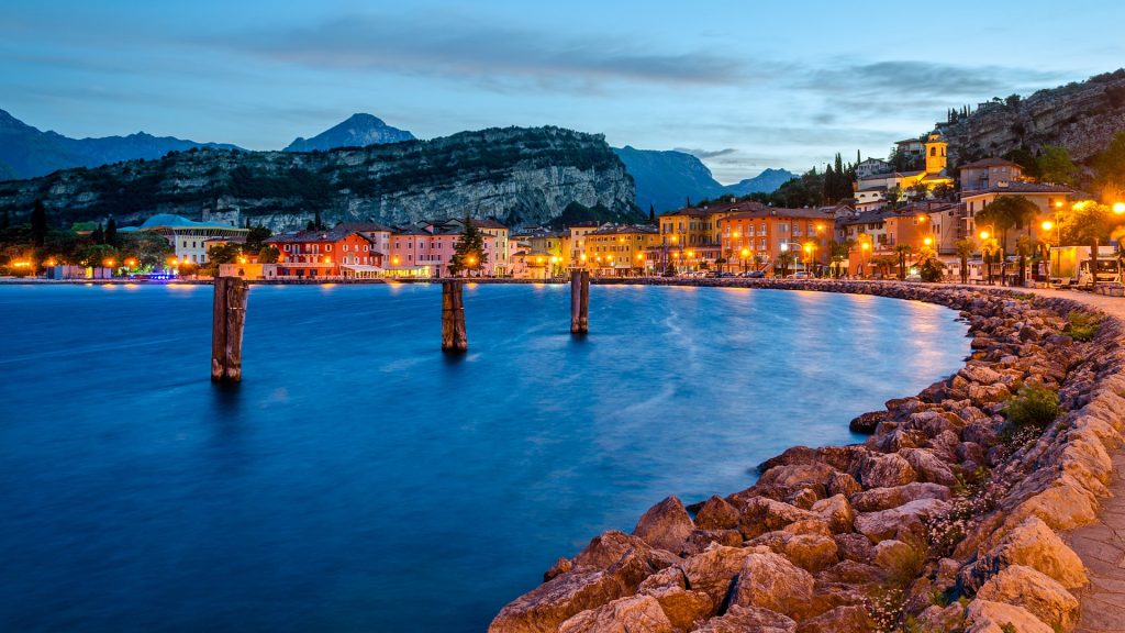 Town of Torbole at early morning, Lake Garda (Lago di Garda) at twilight, Trentino, Italy