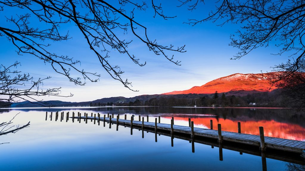 Old Man of Coniston from Coniston water at sunrise, Lake District National park, Cumbria, England, UK