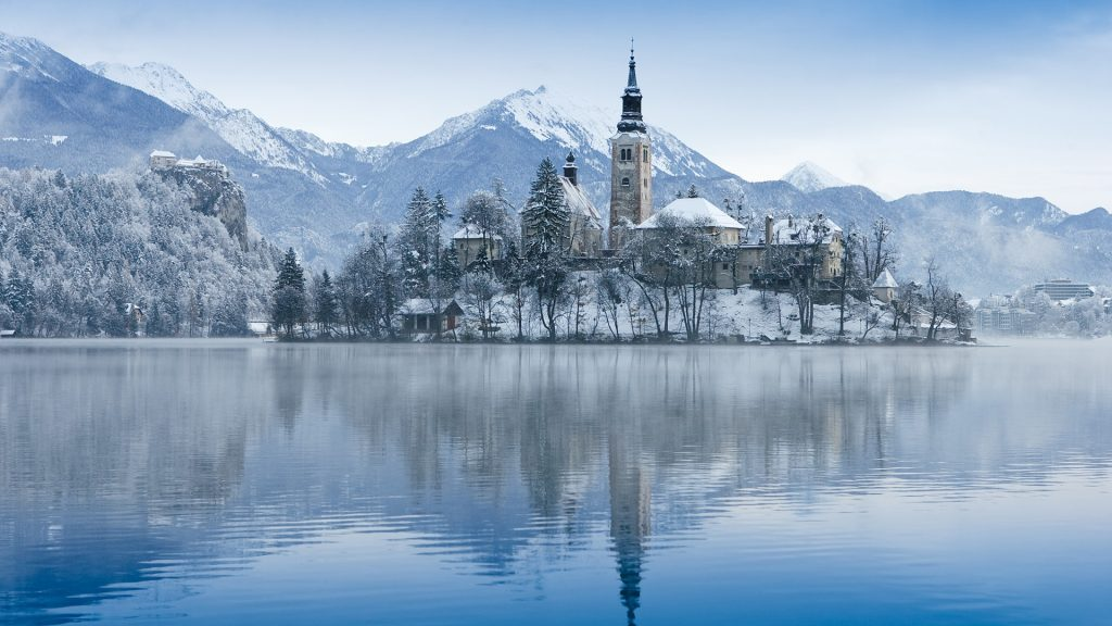 View of church on island on Lake Bled in winter, Slovenia