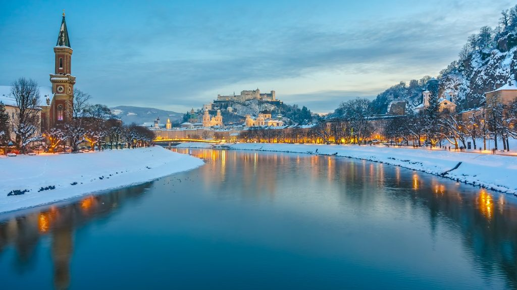 Historic city of Salzburg with Salzach river in winter during blue hour, Salzburger Land, Austria