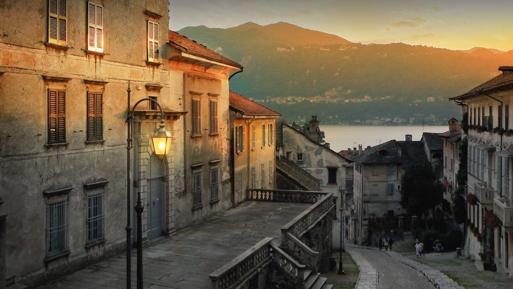 Golden evening sun over Orta san Giulio town next to Orta Lake (Lago d'Orta), Lombardia, Italy