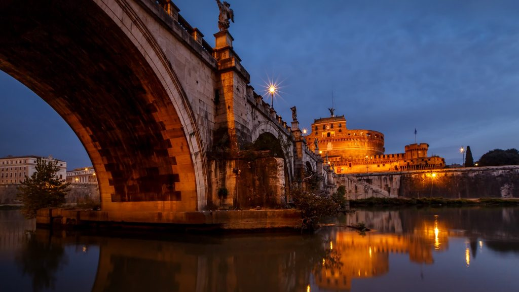 Castle of Holy Angel and Holy Angel Bridge over the Tiber River at dawn, Rome, Italy
