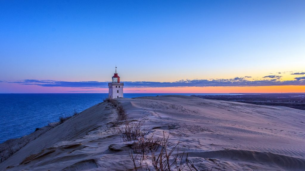 Sunrise at the lighthouse of Rubjerg Knude near Hjørring, Denmark