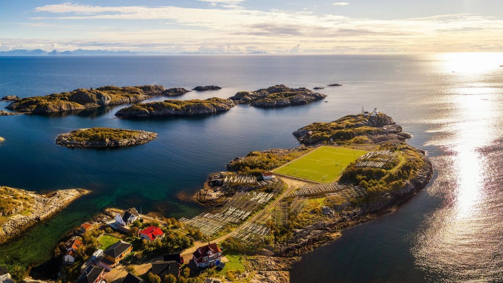 Aerial view of Henningsvær village with its football field, Lofoten archipelago, Norway