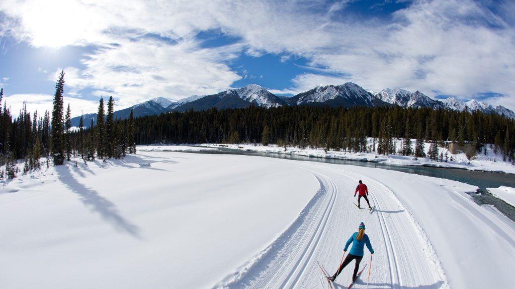 A man and woman enjoy a cross-country skate ski in the Rocky Mountains of British Columbia, Canada