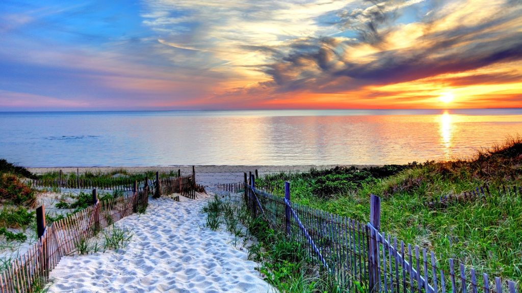 Path with fence leading to a beach at sunset near Provincetown on Cape Cod, Massachusetts, USA