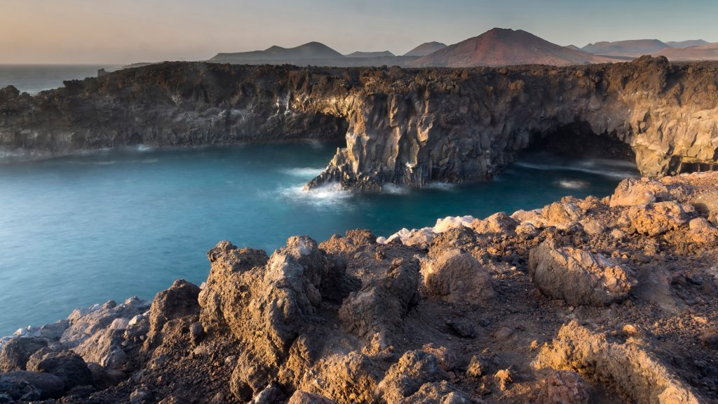 Lava cliffs and volcano skyline, Timanfaya National Park, Lanzarote, Canary Islands, Spain