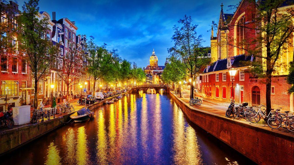 Basilica of Saint Nicholas view from Oudekennissteeg bridge, Amsterdam, Netherlands