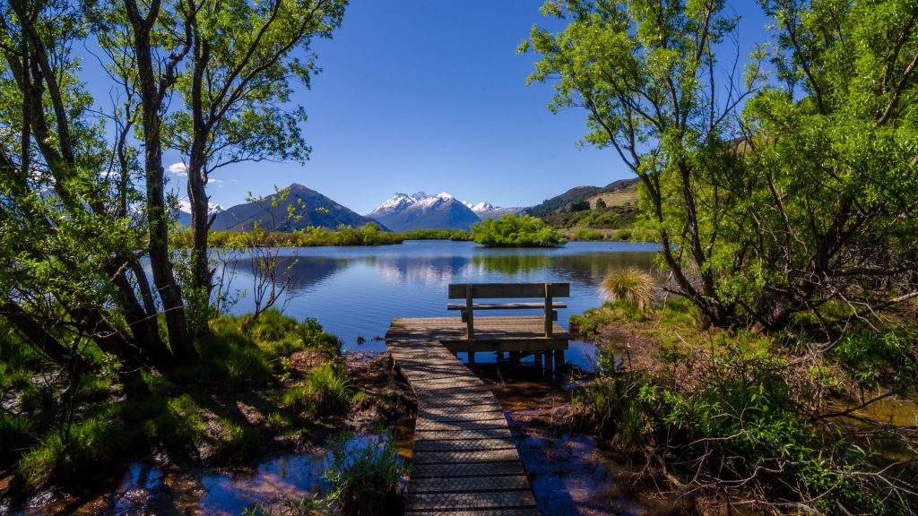 Bench and footpath boardwalk at Wakatipu lake lagoon, Glenorchy, New Zealand