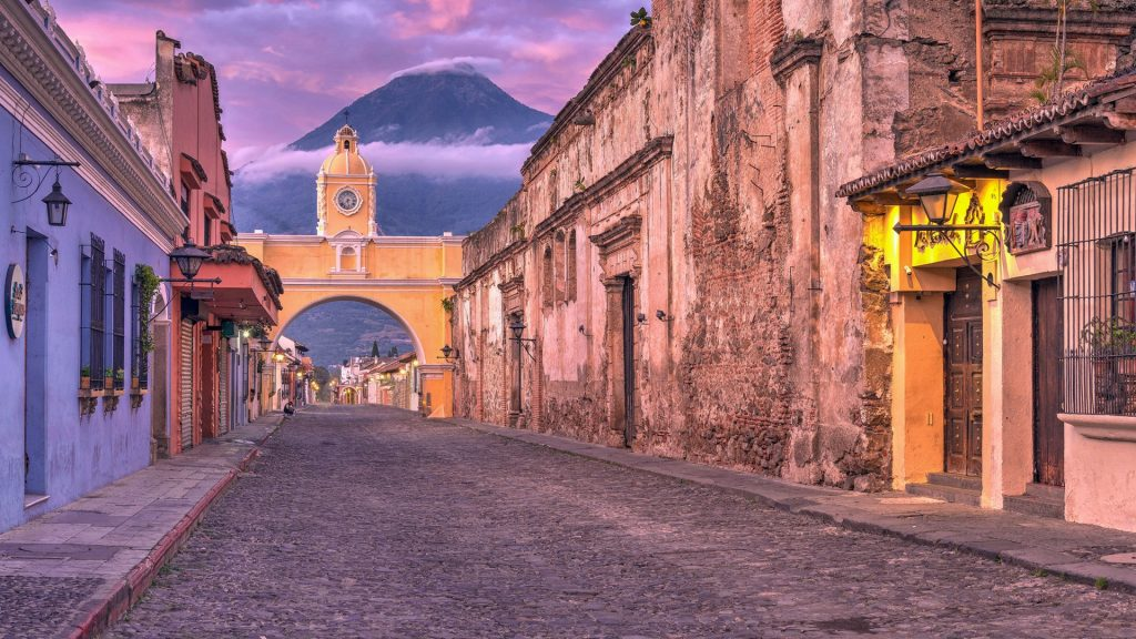 The Santa Catalina Arch (Arco de Santa Catalina) at sunrise, Antigua, Guatemala