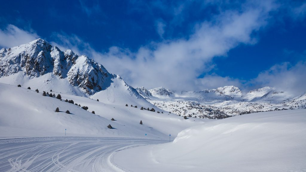 Fresh ski slope and mountains in Pyrenees at sunny day, Soldeu, Andorra