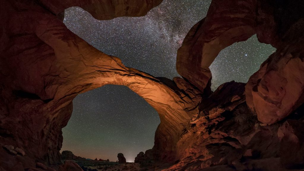 Extreme wide angle image of the starry sky above the Double Arch, Moab, Utah, USA