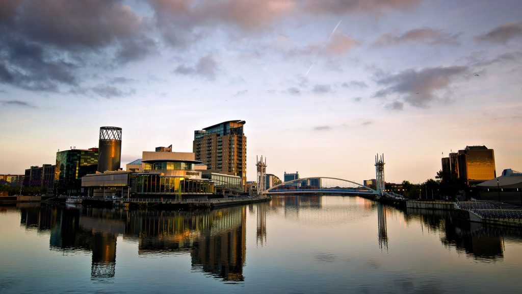 Lowry Theatre and bridge reflections at sunset, Salford Quays, Manchester, England, UK