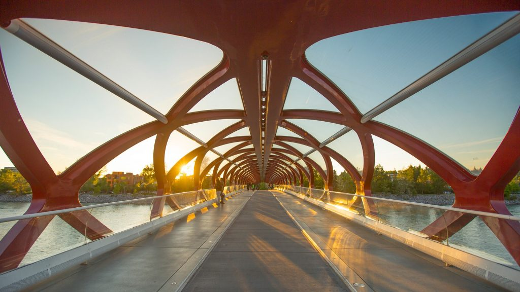 Pedestrian Peace Bridge to Prince's Island Park over Bow River at sunset, Calgary, Alberta, Canada