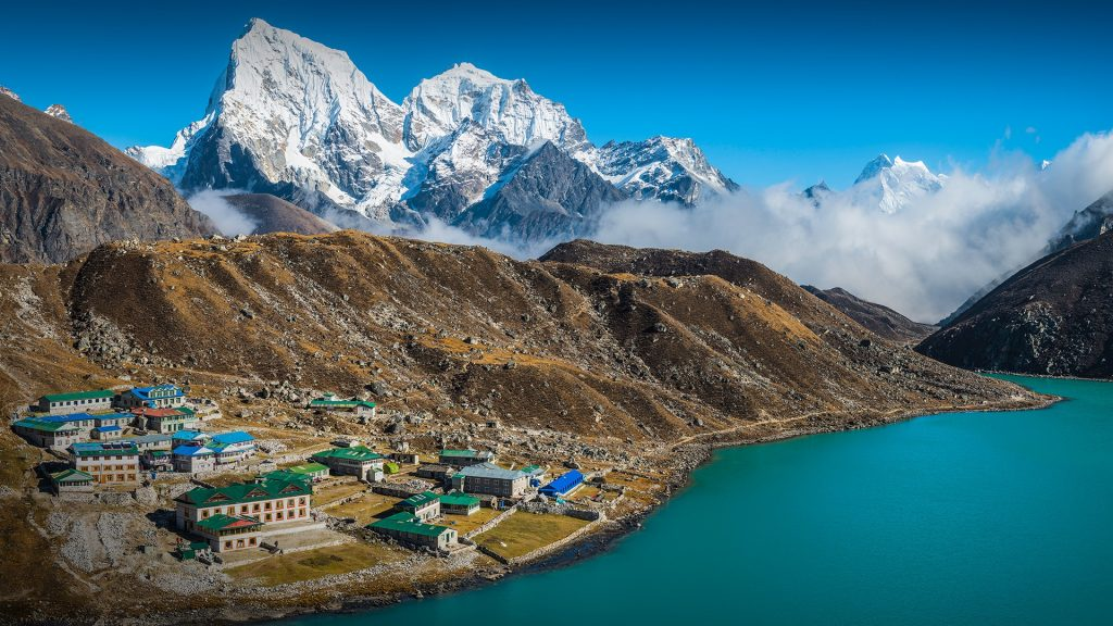 Sherpa village teahouses at Gokyo overlooked by Himalayan mountain peaks, Nepal