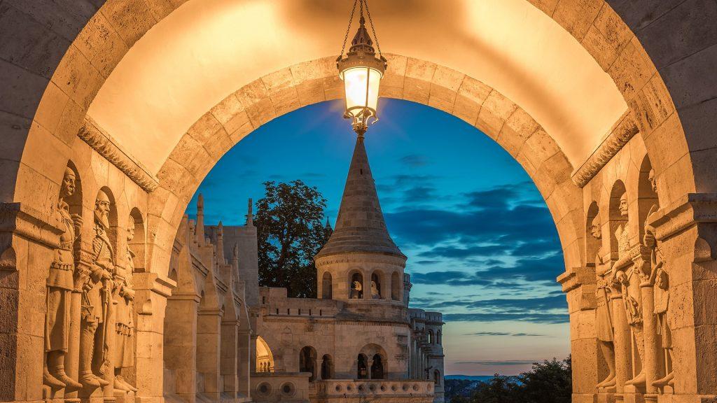 The South gate and Guardians of the Fisherman`s Bastion Halaszbastya at sunrise, Budapest, Hungary