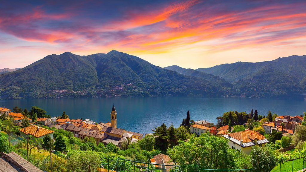 Colorful summer sunrise on the town of Carate Urio on Lake Como, Lombardi, Italy