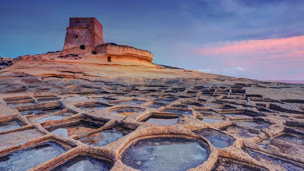 Watchtower and salt pans at sunset, Xlendi, Gozo Island, Malta