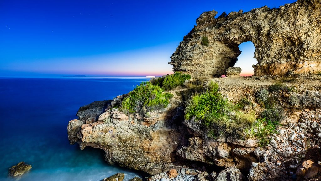 Natural arch rock formation at Dhërmi beach near Himarë, Vlorë County, Albania